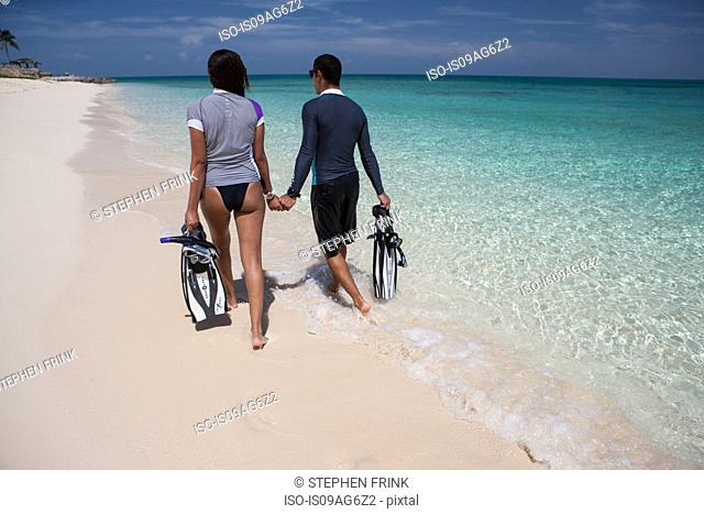 Couple strolls on beach