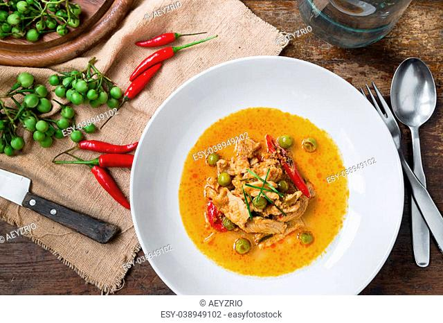 Panang Curry with Pork on wooden table