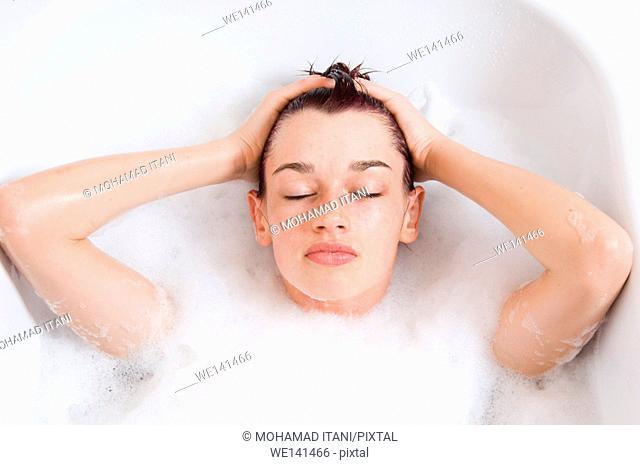 Young woman having a relaxing bubble bath