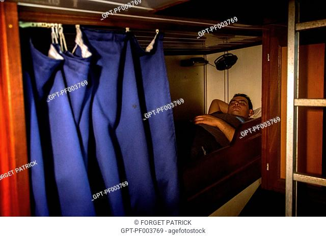 NIZAR IN THE SLEEPING CABIN IN THE BOTTOM OF THE BOAT, SEA FISHING ON THE SHRIMP TRAWLER 'QUENTIN-GREGOIRE' OFF THE COAST OF SABLES-D'OLONNE (85), FRANCE