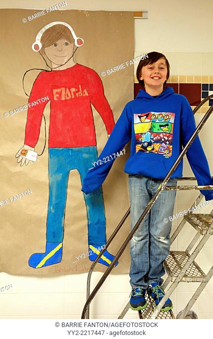 6th Grade Boy Posing With Art Project, Wellsville, New York, United States