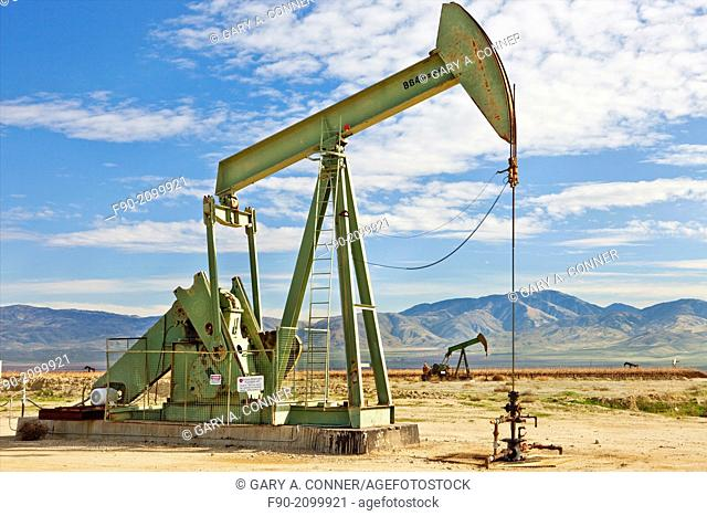 Oil well with pump at Kern Co. California
