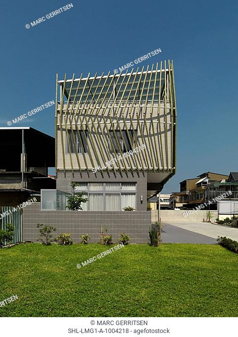 Exterior of modern home covered in bamboo