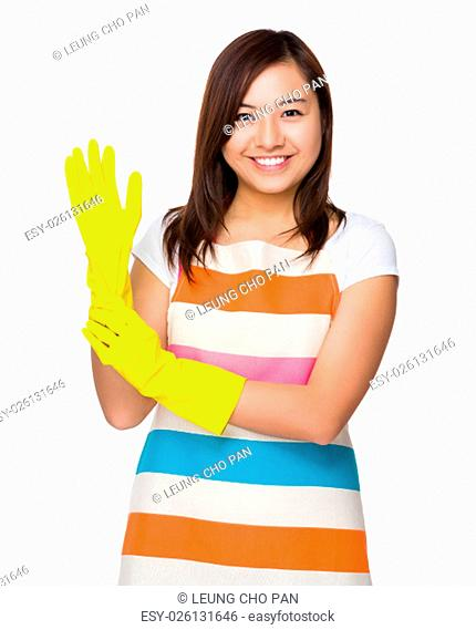 Young housewife wear with plastic gloves