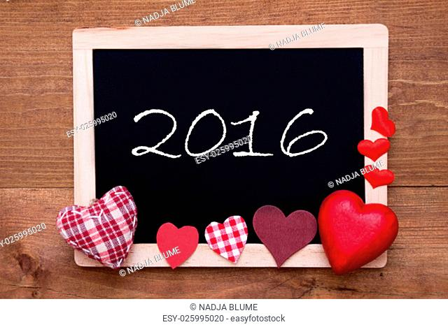 Blackboard With Text 2016. Red Textile Hearts. Wooden Background With Vintage, Rustic Or Retro Style