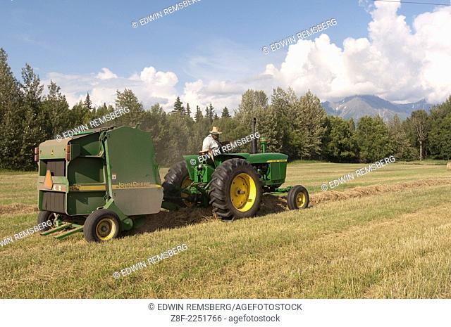 Tim McGinn of Broken Spoke Farm baling hay, Palmer Alaska