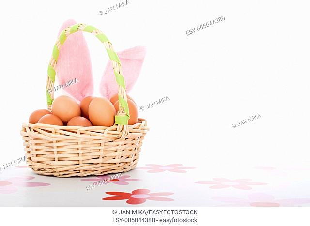 Easter basket with eggs and bunny ears, Easter decoration background with copy space, isolated on white background
