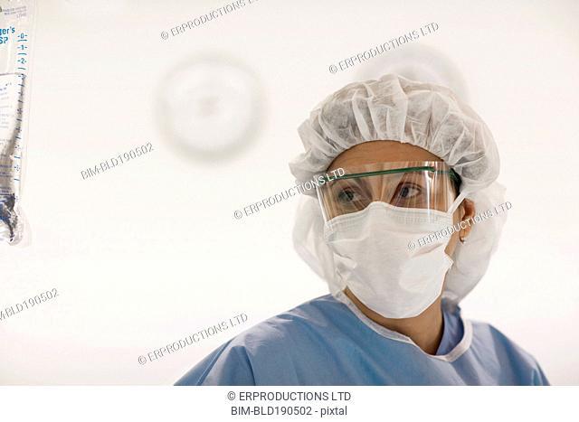 Hispanic female medical professional wearing protective eyewear