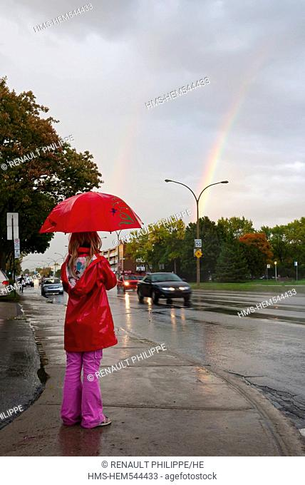 Canada, Quebec Province, Montreal, Boulevard Henri Bourassa, young girl with a red umbrella in front of a rainbow