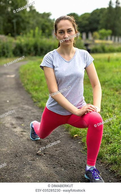 Young girl warmed up in the Park before Jogging