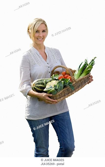 Cut Out Of Woman With Basket Of Organic Produce