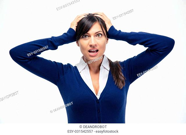 Shocked businesswoman looking at camera isolated on a white background