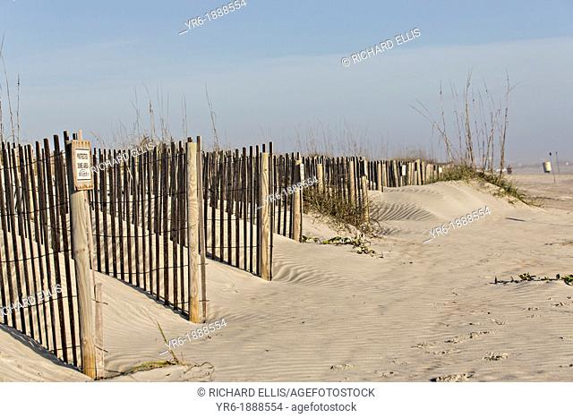 Sand fence to rebuild the dunes on St Augustine Beach, Florida