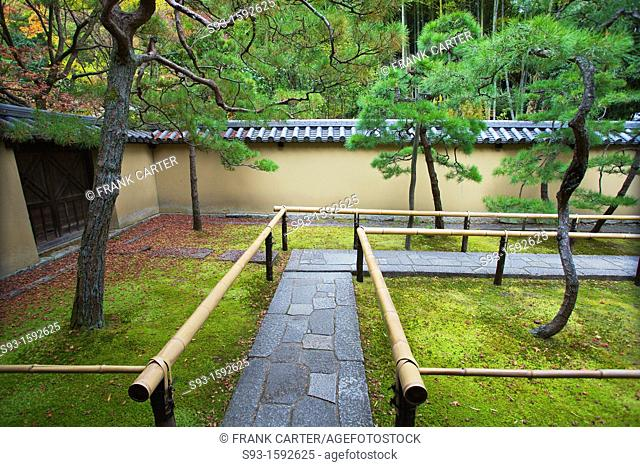 A view of a small temple walkway through moss covered grounds at Daitokuji temple