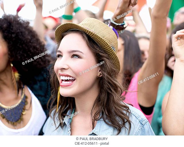 Happy woman at music festival