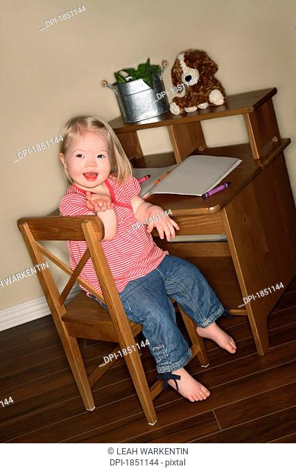 Young girl sitting at her desk