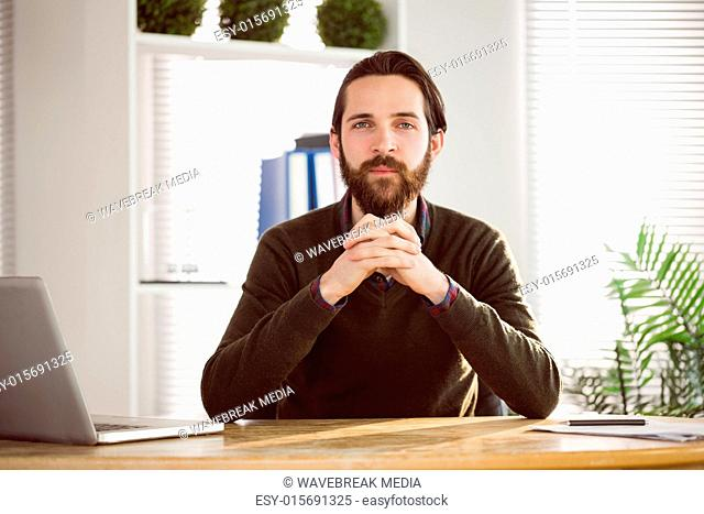 Hipster businessman looking at camera