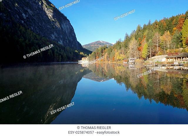 autumn morning on lake tristach tyrol