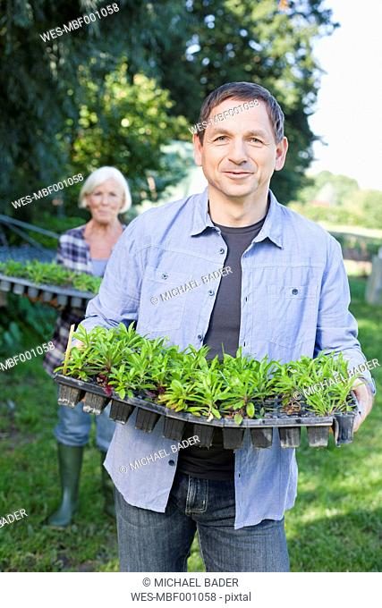 Germany, Saxony, Man and woman at the farm, smiling, portrait