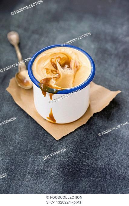 Homemade creamy caramel and cinnamon ice cream with caramel sauce