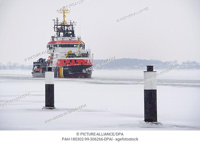 02 March 2018, Germany, Stralsund: The icebreaker 'Arkona' of the Federal Waterways and Shipways Office Stralsund enters the harbour through the Strelasund