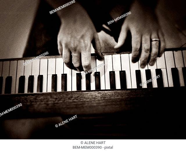 Caucasian man playing piano