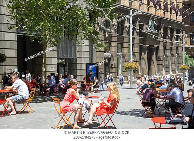 Freinds meet and socialise in Martin Place,Sydney city centre,Australia