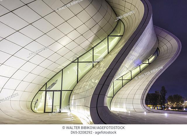 Azerbaijan, Baku, Heydar Aliyev Cultural Center, building designed by Zaha Hadid, exterior, dusk