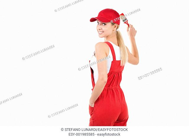 Young woman painting, copy space for your own red painting/mural