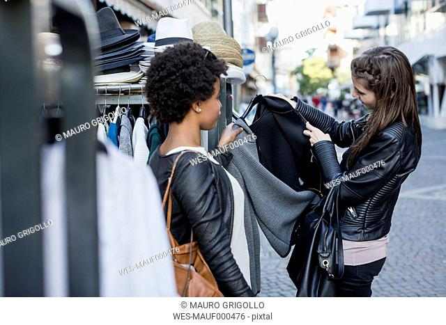 Young women shopping for clothes in the city