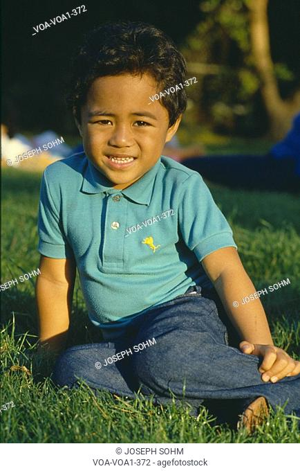 Samoan boy in a park, Los Angeles, California
