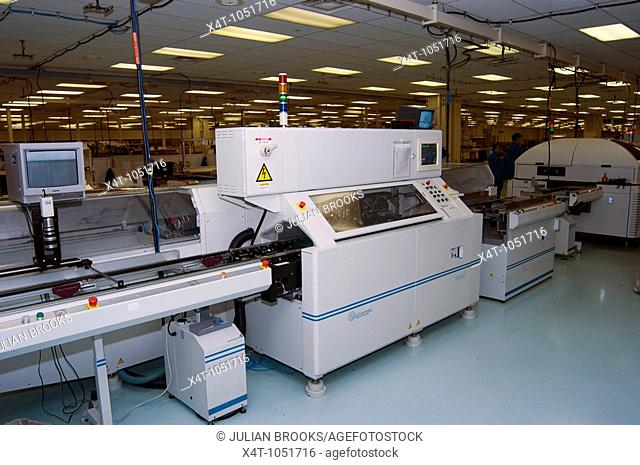 International Systems component insertion machine using embedded systems technology to make circuit boards