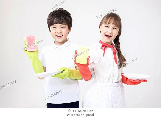 a boy and a girl washing dishes