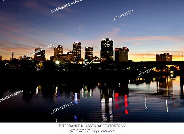 The Arkansas river and the city skyline of Little Rock Arkansas at dusk