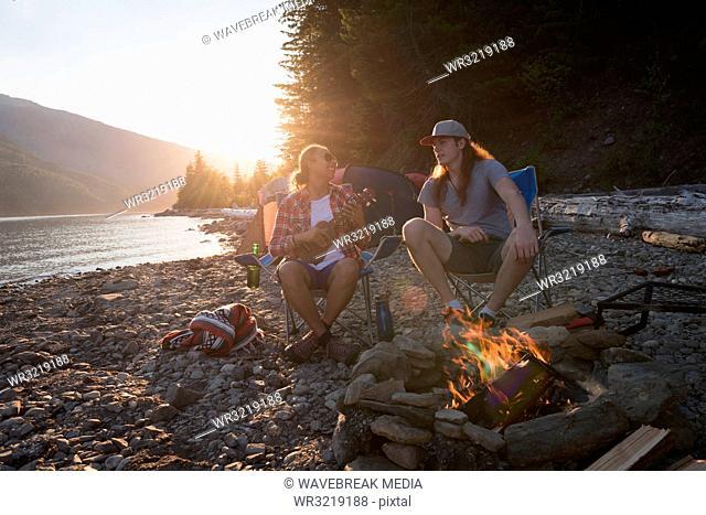 Couple camping near riverside