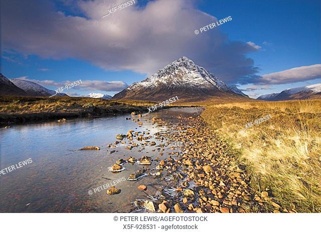 Snow covered Buachaille Etive Mor reflected in the River Etive Glen Coe Scotland