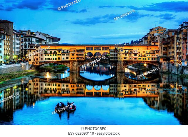 Ponte Vecchio bridge in Florence, Italy. Arno River at night. Tuscany