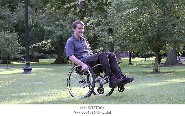 Man with spinal cord injury turning his wheelchair in a park