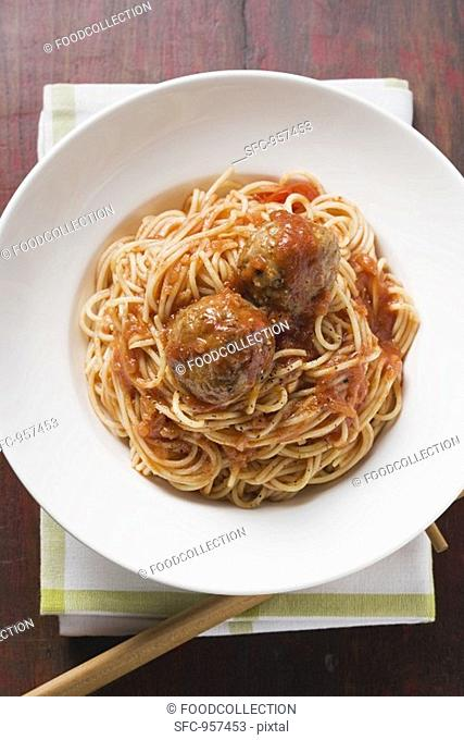 Spaghetti with meatballs and tomato sauce overhead view