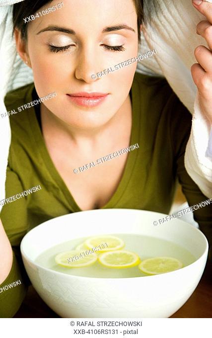 young woman inhaling vapors