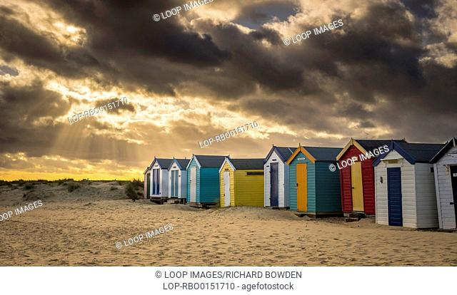 Stormy skies over the Southwold beach huts