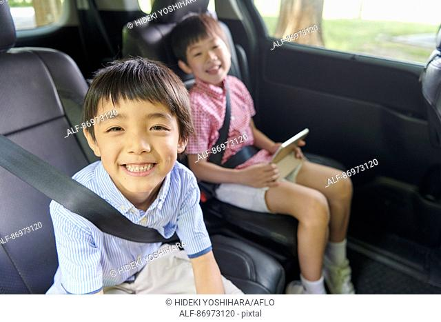 Japanese kids in the car