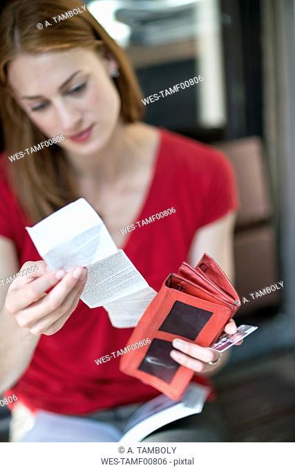 Woman checking sales slip