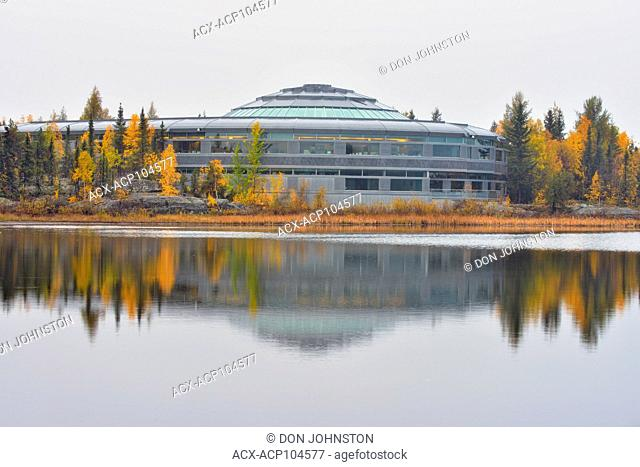 NWT Legislature reflected in Range Lake in autumn, Yellowknife, Northwest Territories, Canada