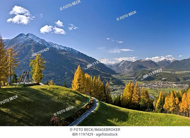 Friedensglocke, Peace Bell, in Moesern, larch trees in autumn, Hocheder in the Stubai Alps, overlooking the Inntal valley, Telfs, Tyrol, Austria, Europe