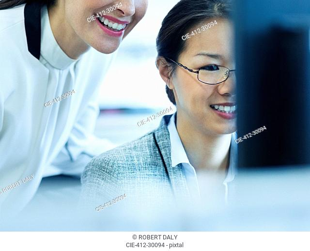 Smiling businesswomen working at computer in office