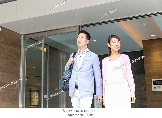 Couple Walking out Automatic Door