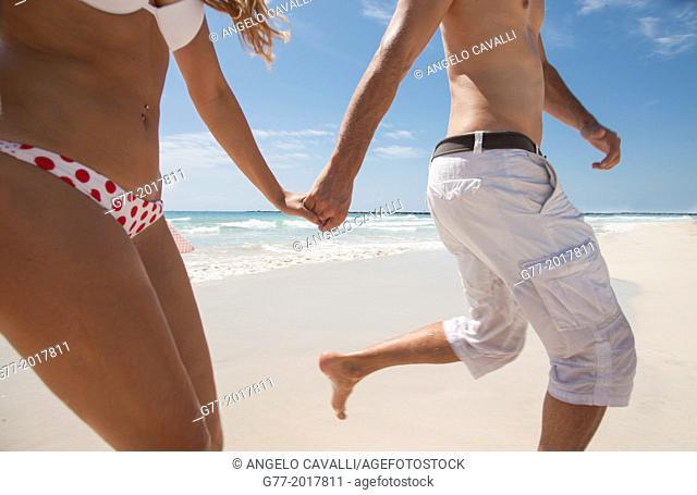 Usa. Florida. Miami Beach. Couple running on a beach