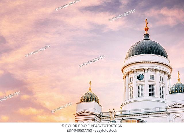 Tower Of Helsinki Cathedral, Helsinki, Finland. Close Up Dome At Summer Sunset Evening With Dramatic Sky In Warm Colors