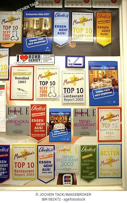 Restaurant guide stickers endorsing a restaurant in Germany, Europe